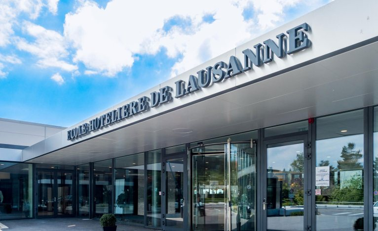 EHL entrance in Lausanne with the name Ecole hôtelière de Lausanne in perspective above the main door.